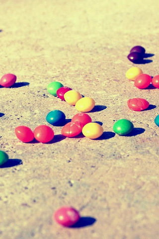 Colorful-Candies-On-The-Ground-iphone-4s-wallpaper-ilikewallpaper_com
